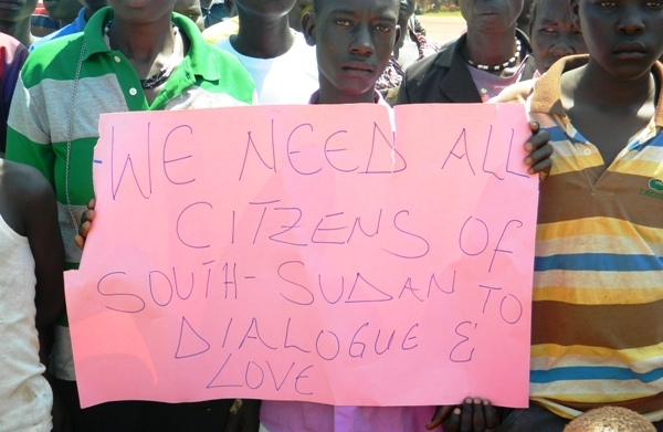 Children hold banners during the Visit of First Vice president Taban Deng Gai to Yei last week