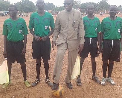 John James Wani centre with referees at Yei Freedom square play ground in November this year